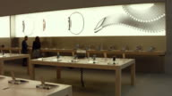 People look at the new Apple Watch at an Apple store in Manhattan on April 10 2015 in New York New York Consumers around the world were able to try...