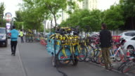 People maintains shared bike in Beijing on May 10 2017 in Beijing China