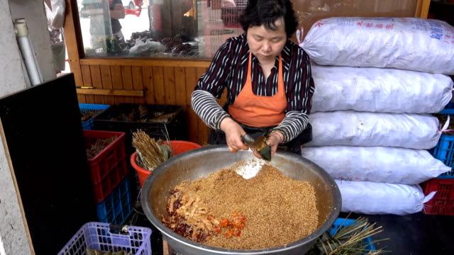 People makes traditional Chinese snack RicePudding on May 20 2017 in Shanghai China