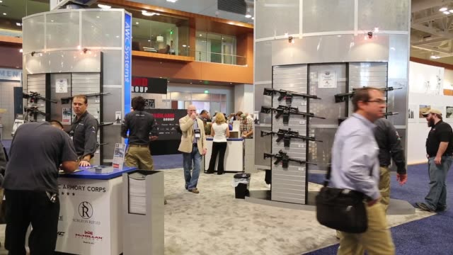 People mill about at the National Rifle Association NRA Annual Meeting Show