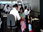 People move through passport control in an airport