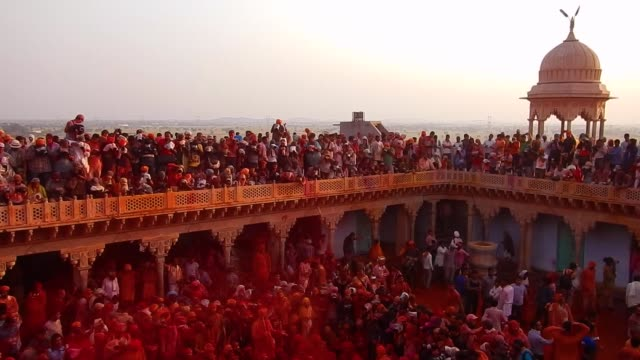 People of Braj singing chants / Religious festivities and celebrations a inside a temple complex during Holi in Nandgaon Mathura the Village of Lord...