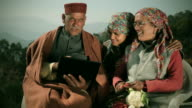 People of Himachal Pradesh: Senior man using laptop with family
