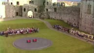 People of Wales remember Charles and Diana's first royal tour AS271081014 / TX High angle shot Caernarfon Castle ceremony before Diana and Charles...