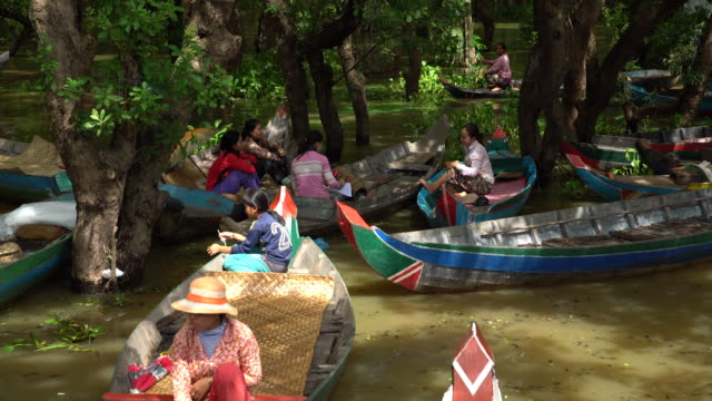 People on Boats on Tonlie Sap Lake