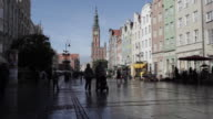 WS People on city street, clock tower in background / Gdansk, Poland