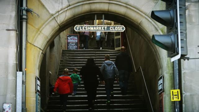 People on Edinburgh Royal Mile Close