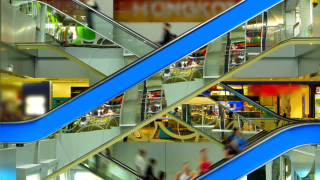 People on escalators at the modern shopping mall