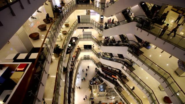 People on fast moving escalator
