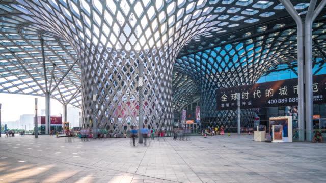 people on floor under modern architecture in Shenzhen timelapse 4k