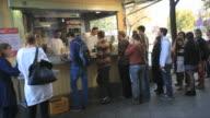 People on kew to Mustafa's Gemüse Kebap, Fast food in Berlin-Mehringdamm street
