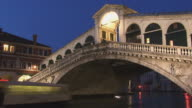MS, T/L, people on Realto bridge over Grand Canal, dusk till night / Venice, Italy