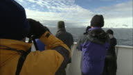 MS, People on ship looking at Antarctic landscape, rear view, Antarctica