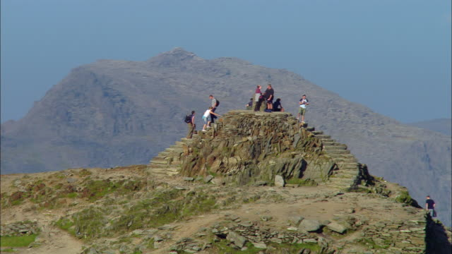 LOW AERIAL, People on Snowdon Mountain summit, Snowdonia National Park, Wales