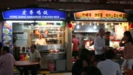 People order dinner at the Maxwell Hawker Market on February 20 2013 in Singapore Hawker centres have grown in popularity in recent years as they...