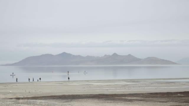 People paddle boarding in Great Salt Lake, wide shot