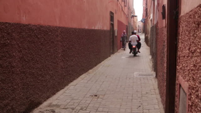 People passing in alley