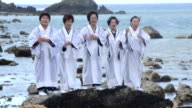 "People perform the 'Hirase Mankai' at beach of Amami Oshima Island on September 17 2015 in Tatsugo Kagoshima Japan ""Hirase Mankai"" is a ritual..."
