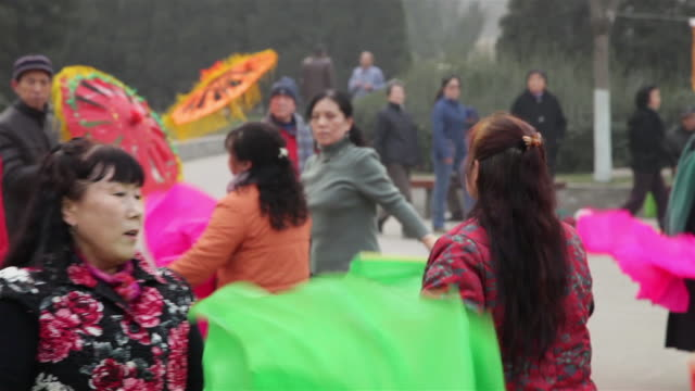 MS People performing yangko dance during Chinese spring festival in park AUDIO / xi'an, shaanxi, china