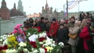People place flowers and candles at the memorial over the bridge where leading Russian opposition leader Boris Nemtsov was shot dead last Friday in...