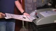 WGN People Placing Ballots Into Voting Machine on Election Day in Chicago on Nov 8 2016