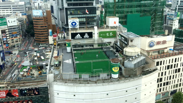 People play football on a rooftop football pitch in Shibuya on September 06 2017 in Tokyo Japan