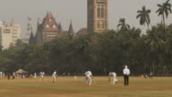 WS People playing cricket in Oval Maidan / Mumbai, India