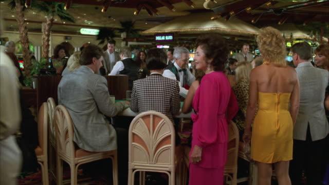 MS PAN People playing in casino at blackjack table / Las Vegas, Nevada, USA