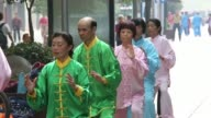 WS People practice tai chi in the East Nanjing Road area