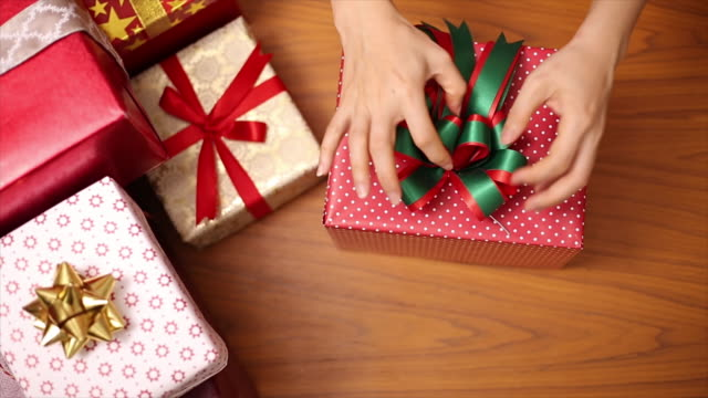 People preparing Christmas gifts for children