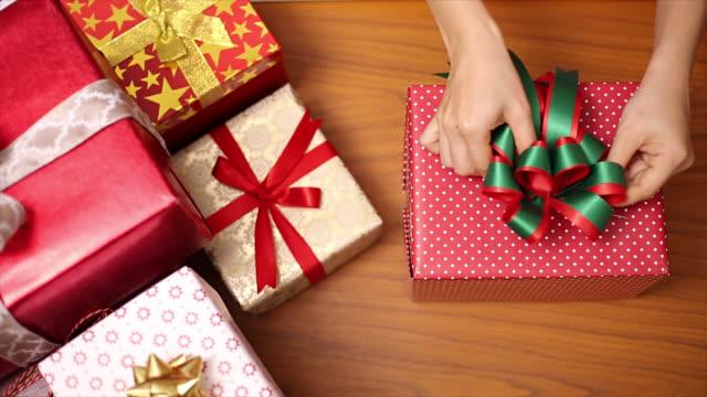 People preparing Christmas gifts