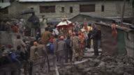 People process across bridge and up steps, Kedarnath, India Available in HD.