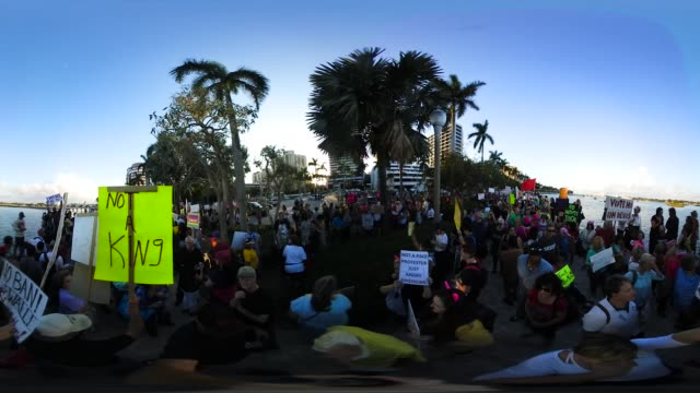 'People protest against President Donald Trump as they gather to walk toward MaraLago Resort where he is staying for the weekend on February 4 2017...
