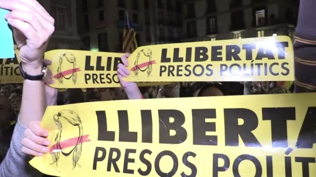 People protest outside Barcelona's city hall after the judge ordered Catalonia's former vice president Oriol Junqueras and seven other deposed...