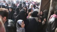 People push and shove outside a bakery in Aleppo Syria Bread was scarce and lines long
