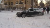 People Pushing Cars Stuck On Snowy Roads the day after the 5th Largest Blizzard in Chicago history on February 02 2015 in Chicago Illinois