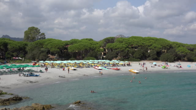 People relax at Cala Liberotto beach