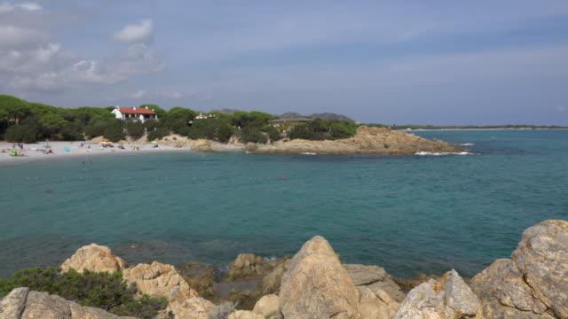 PAN / People relax at Cala Liberotto beach