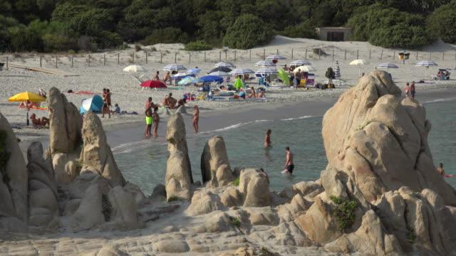 People relaxing at Villasimius beach