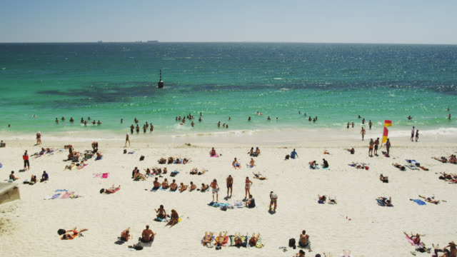 WS People relaxing on sand at Cottesloe beach  / Perth, Western Australia, Australia