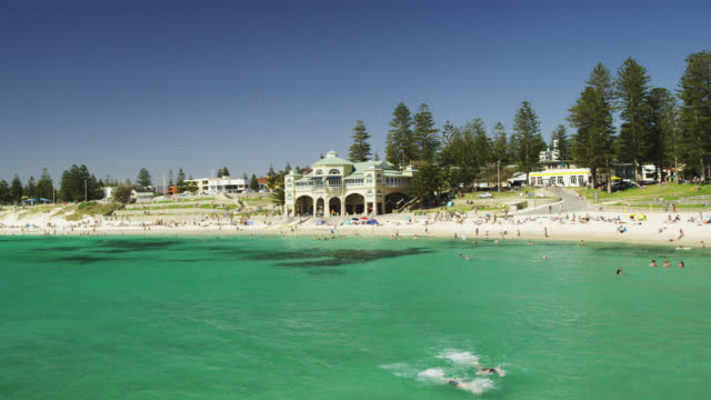 WS PAN People relaxing on sand at Cottesloe beach  / Perth, Western Australia, Australia
