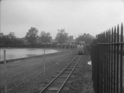 People ride a minature railway at Alexandra Park in London