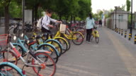 People ride shared bike on May 7 2017 in Beijing China