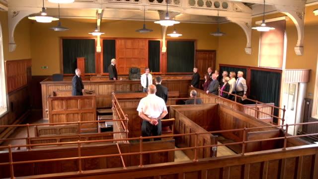 People rise as Judge walks into Court -Crane