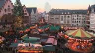 WS People roaming and enjoying at christmas market at Romer Square / Frankfurt, Main, Hesse, Germany