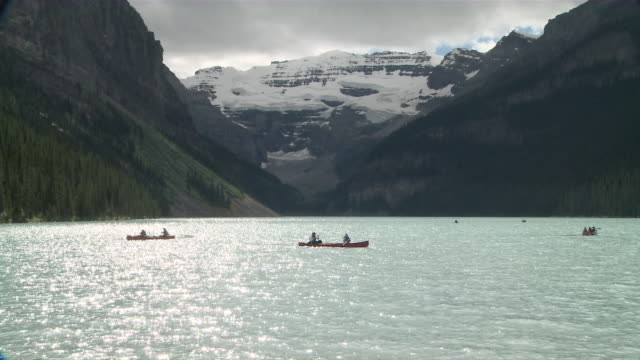 WS People rowing boats in lake / Banff National Park, Alberta, Canada
