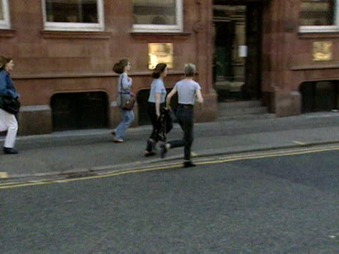 People run along the street during the aftermath of the Manchester IRA bomb explosion