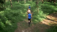 AERIAL People running in the forest