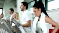 People running on treadmill