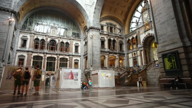 LA T/L People Rushing Through the Historic Antwerp Central Station